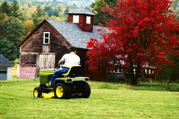 riding lawn mower man in fall 3 - Fall Seeding and Fertilizing